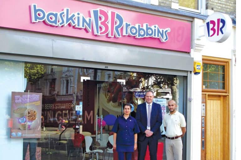 a branch of baskin robbins with employees